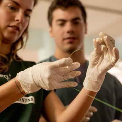 Female Projects Abroad Medicine intern learns how to tie a sature at a hopsital as part of her medical work experience in Argentina.